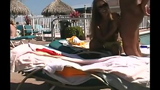 Young blonde sucks and fucks at the pool while being watched by onlookers