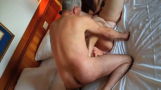 Chubby wife gobbles on a pair of horny dicks shared by husband